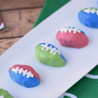 OREO Cookie Balls decorated in red and blue, and green and blue team colors.
