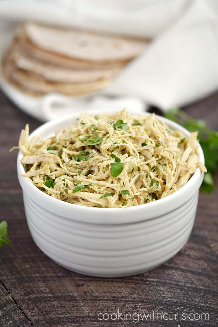 This Instant Pot Salsa Verde Shredded Chicken is versatile enough to be used as a filling for burritos, and as a topping for salads | cookingwithcurls.com