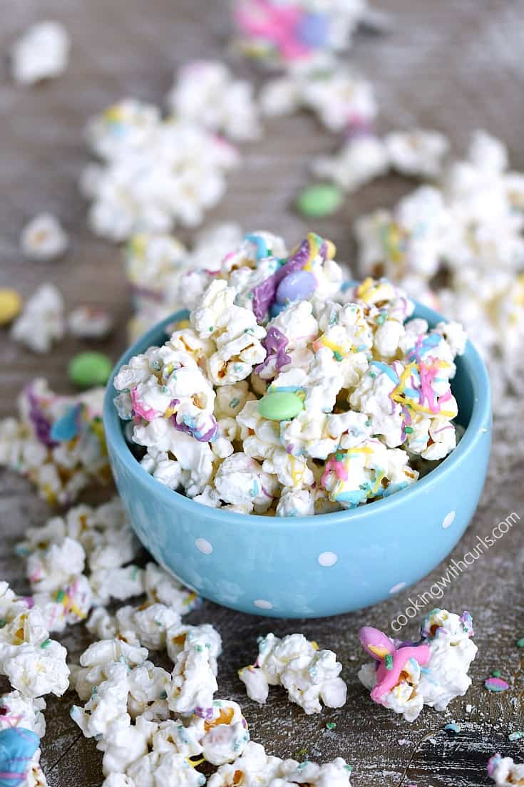 This Springtime Chocolate Covered Popcorn is sweet and delicious covered in colorful chocolates   cookingwithcurls.com