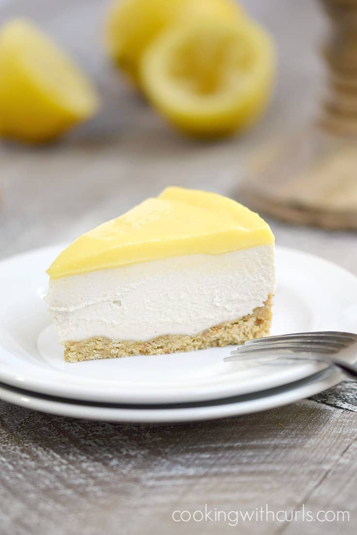A slice of this thick and creamy Paleo Lemon Cheesecake is the perfect way to end a healthy meal | cookingwithcurls.com