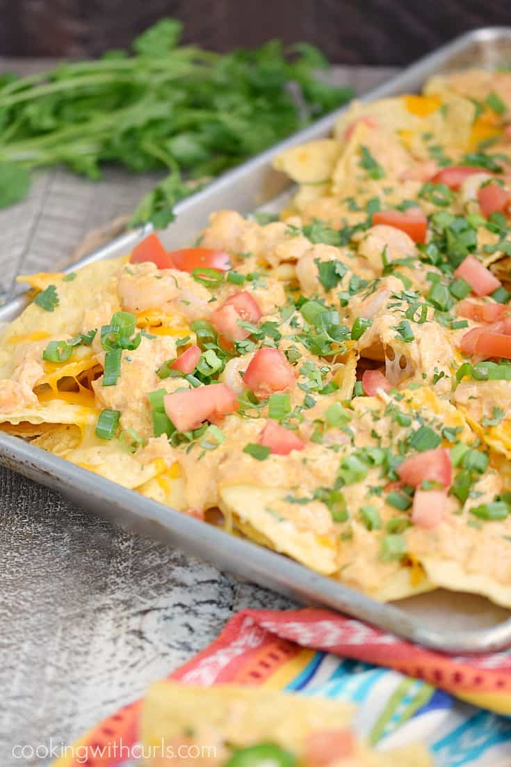 Celebrate Cinco de Mayo with a pan of Creamy Seafood Nachos and watch your guest devour them! cookingwithcurls.com #ad