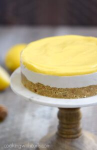 The only thing missing from this rich and creamy Paleo Lemon Cheesecake is the calories! cookingwithcurls.com #feastndevour