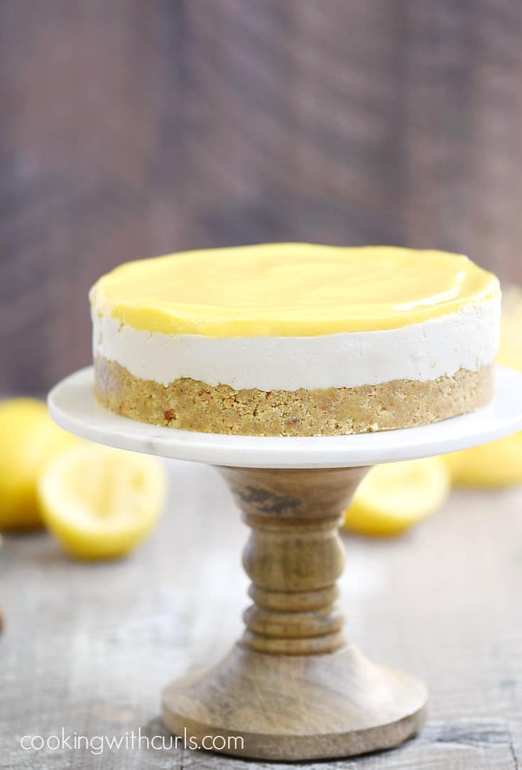 This Paleo Lemon Cheesecake is thick and creamy, while still being dairy, grain, and refined sugar-free | cookingwithcurls.com