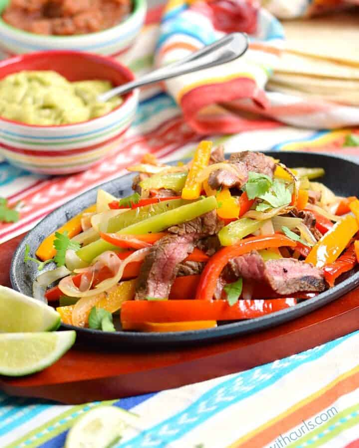 You will be shocked when you realize how easy it is to make restuarant-style Grilled Steak Fajitas at home! cookingwithcurls.com