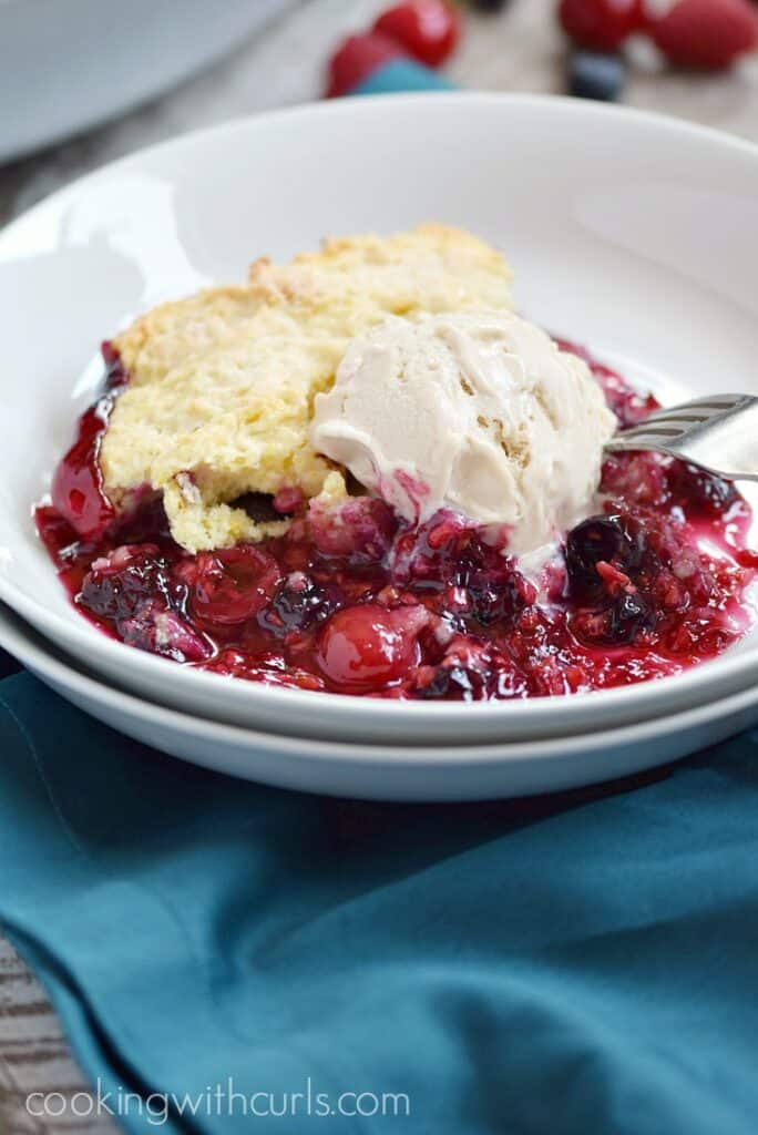 Very Berry Cobbler topped with vanilla ice cream | cookingwithcurls.com