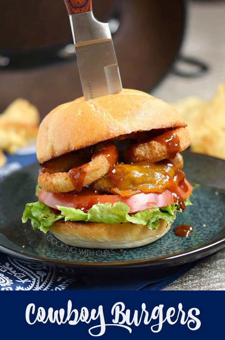 These flame grilled Cowboy Burgers are basted with tangy barbecue sauce, then topped with melted cheese, crispy onions rings and a toasted bun for the perfect summer burger!! cookingwithcurls.com