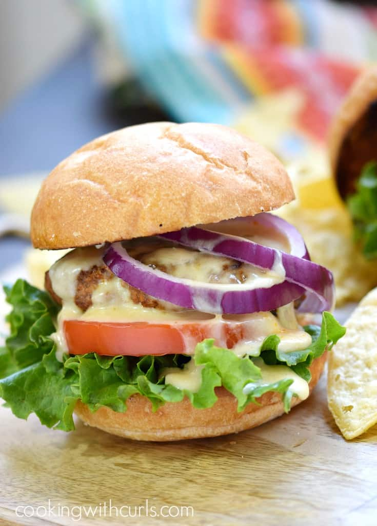 Grab some napkins and bite into these flavorful Mexican Burgers with Queso Blanco | cookingwithcurls.com