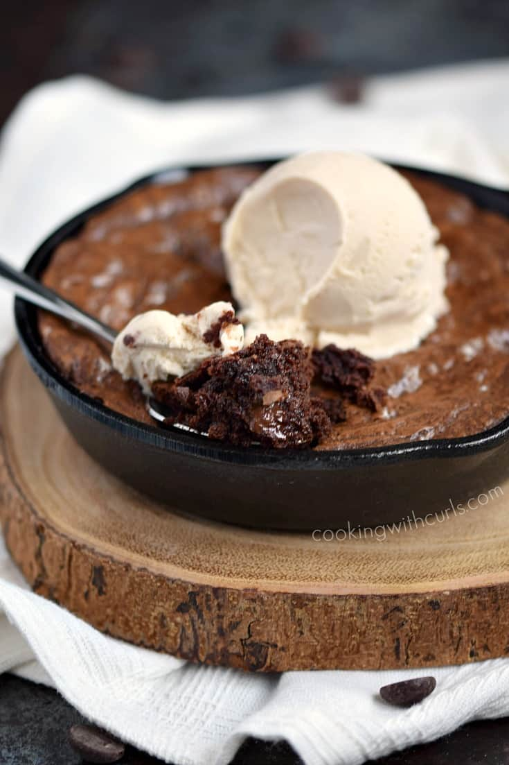 Grab two spoons and dive into this chewy and delicious Skillet Brownies for Two topped with a scoop of vanilla ice cream! cookingwithcurls.com