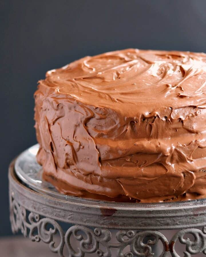 Old-Fashioned Chocolate Fudge Cake on a crystal cake stand.
