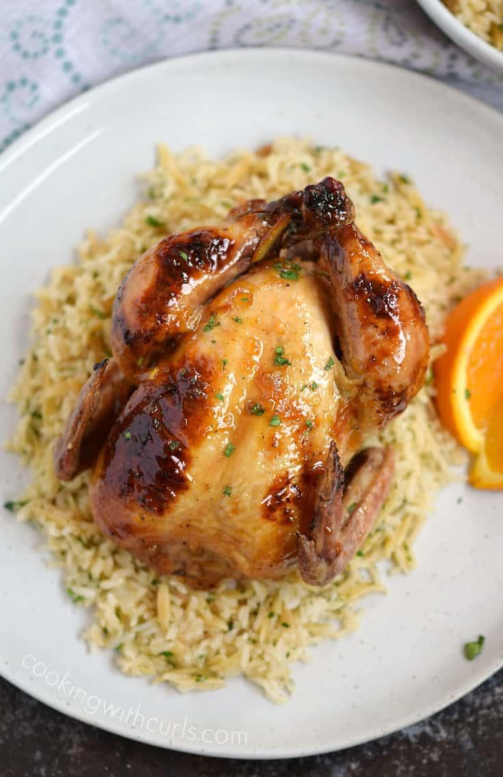 Orange Glazed Cornish Game Hens served on a bed of Rice Pilaf | cookingwithcurls.com