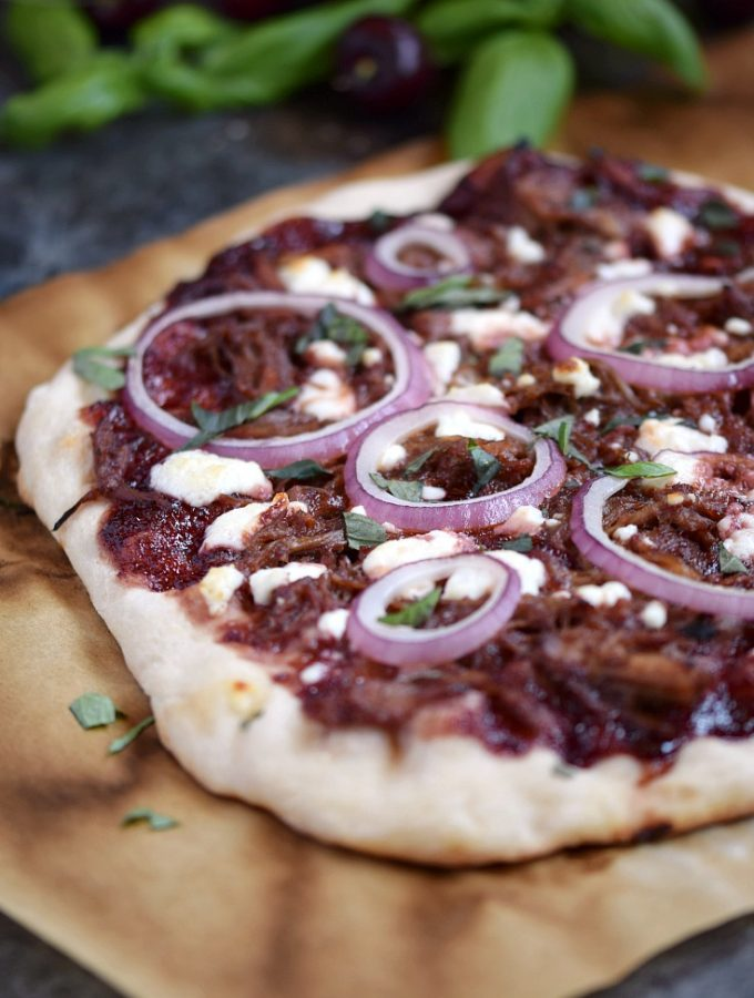The sweet and tangy combination on this Cherry Bourbon Barbecue Pork Pizza will make this a family favorite | cookingwithcurls.com