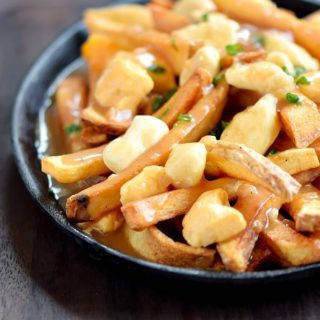 This is my take on Canadian Poutine, and it is delicious! cookingwithcurls.com