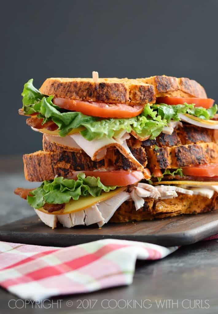 Bacon Turkey Bravo Sandwich recipe on Tomato Basil Bread with crispy bacon, gouda cheese, sliced turkey, lettuce, and tomato | COPYRIGHT © 2017 COOKING WITH CURLS