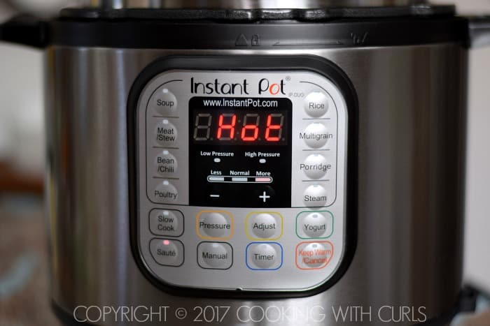 Instant Pot with HOT on the display.