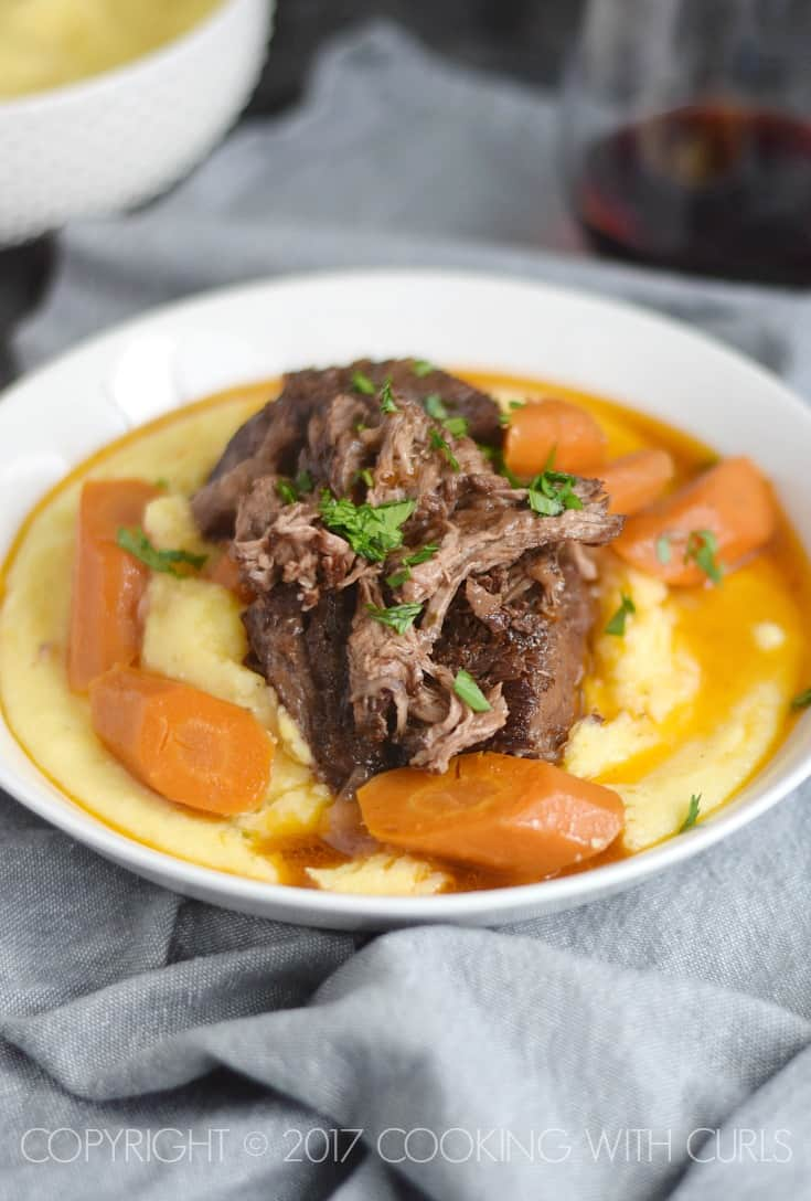 Instant Pot Wine Braised Beef Short Ribs is going to become your favorite meal, it's my new favorite!! COPYRIGHT © 2017 COOKING WITH CURLS