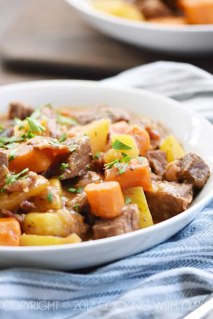 This Instant Pot Irish Beef Stew is loaded with tender beef chunks, carrots, and potatoes in a rich gravy that will make the whole family happy! COPYRIGHT © 2017 COOKING WITH CURLS