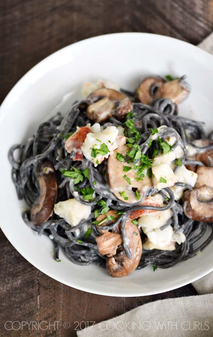 This Squid Ink Pasta with Lobster Cream Sauce is the perfect way to change things up on your next date night! COPYRIGHT © 2017 COOKING WITH CURLS