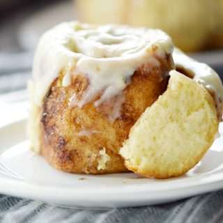 Cinnamon and brown sugar are surrounded by light and fluffy layers of sweet dough to create The Best Cinnamon Rolls that will ever come out of your oven! COPYRIGHT © 2017 COOKING WITH CURLS