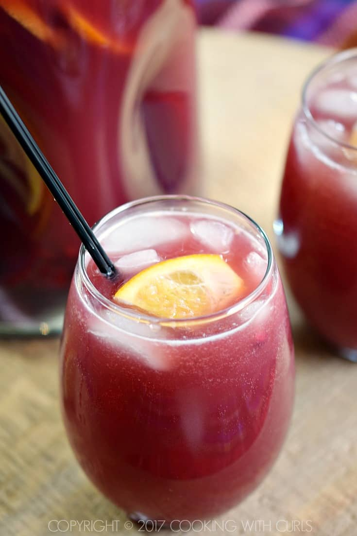 Pomegranate Orange Holiday Punch is a fruity, fizzy and delicious cocktail that your party guests will love! COPYRIGHT © 2017 COOKING WITH CURLS