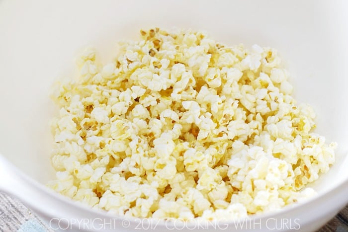 Salsa Verde Popcorn toss with butter COPYRIGHT © 2017 COOKING WITH CURLS