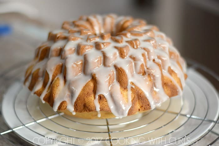 Spiked Eggnog Bundt Cake pour glaze over cake COPYRIGHT © 2017 COOKING WITH CURLS