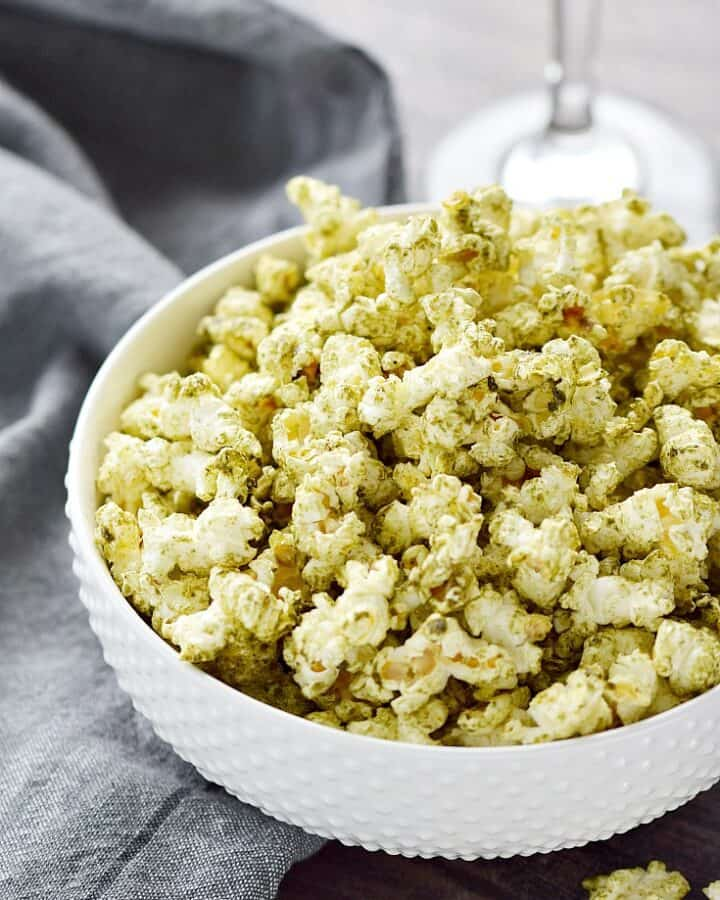 Salsa Verde Popcorn in a white bowl.