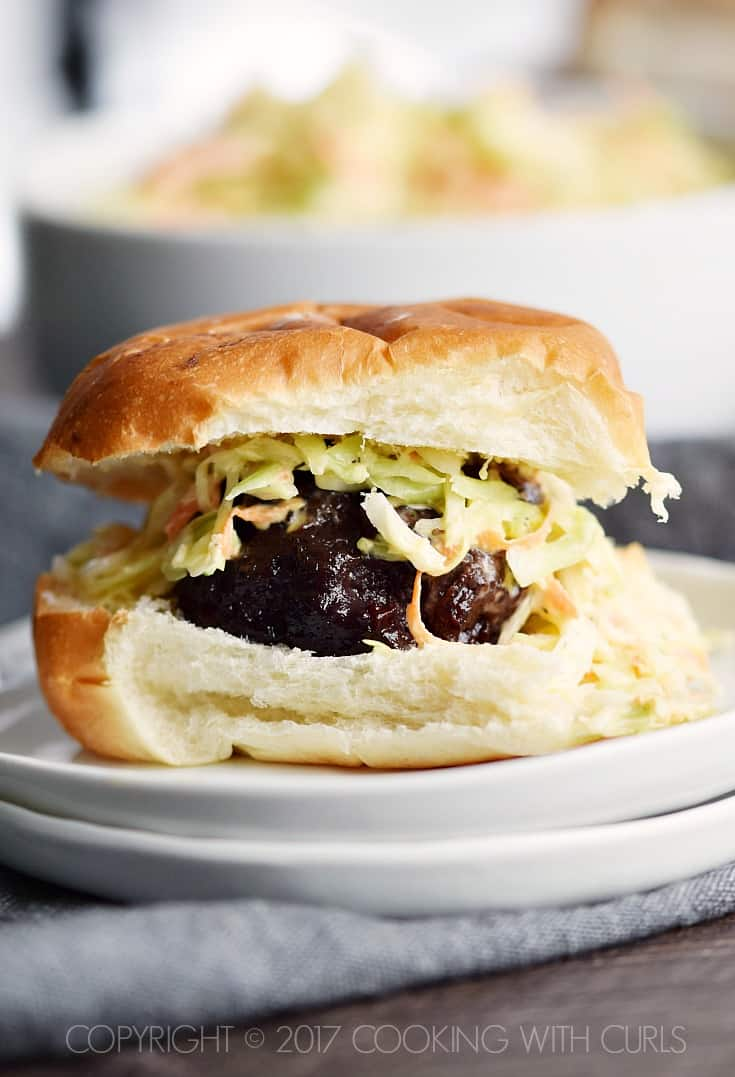 These Blackberry-Bourbon Burger Sliders are topped with Creamy Coleslaw and make the perfect appetizer for your next party! COPYRIGHT © 2017 COOKING WITH CURLS