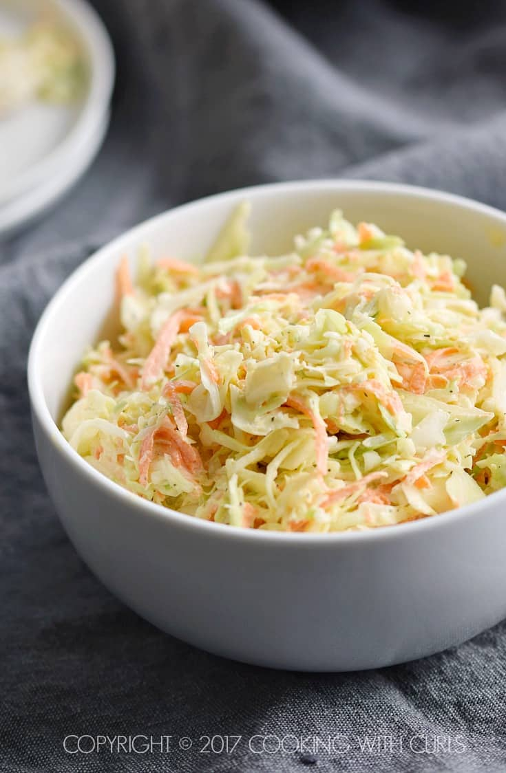 This Creamy Coleslaw is ready in minutes for your next party or barbecue! COPYRIGHT © 2017 COOKING WITH CURLS
