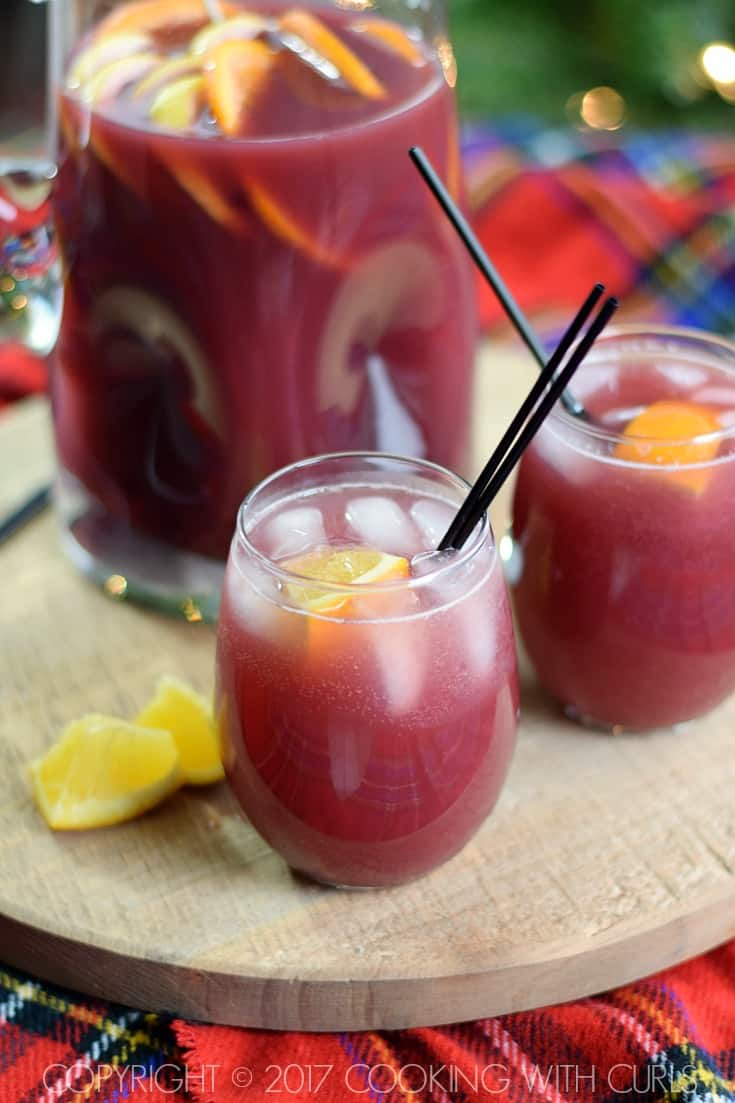 This Pomegranate Orange Holiday Punch is super easy to prepare and sure to be a huge hit at your next party! COPYRIGHT © 2017 COOKING WITH CURLS