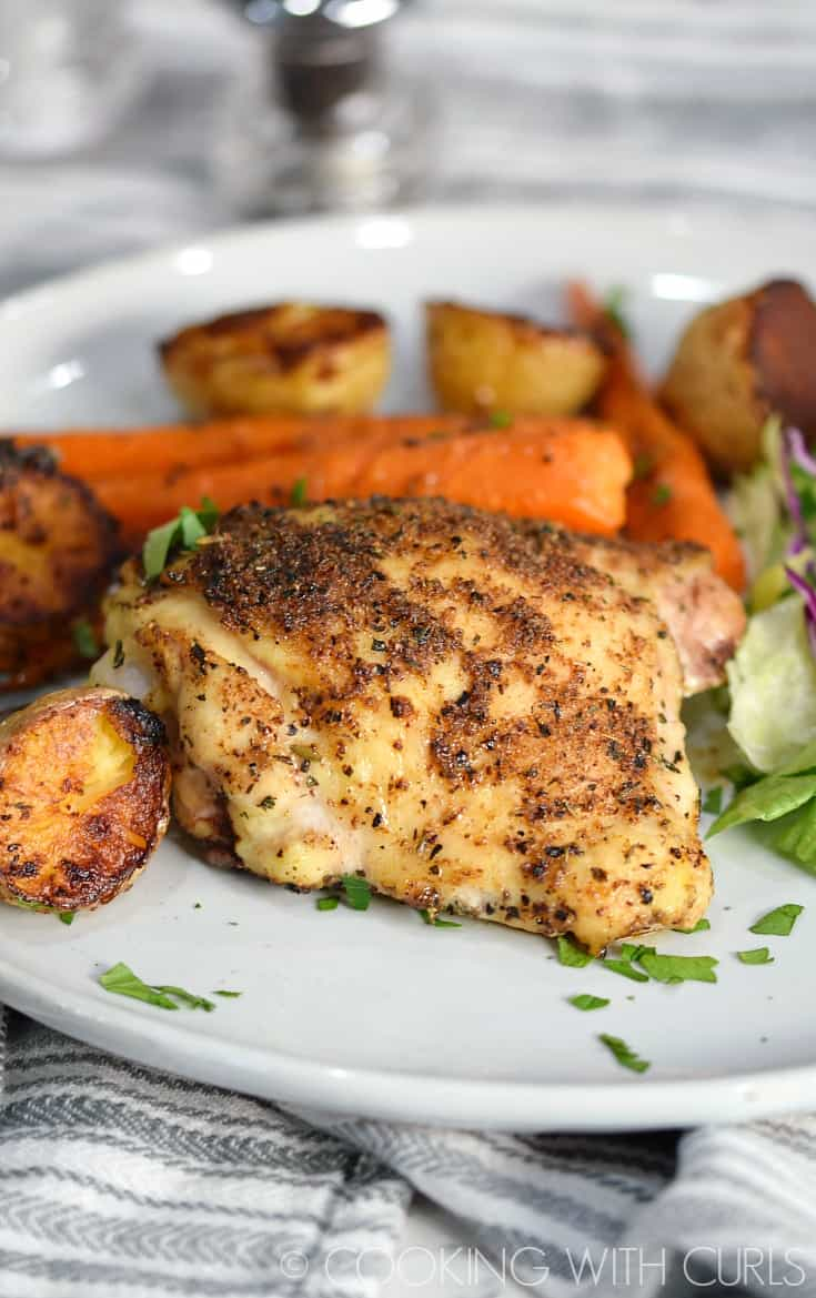 Sheet Pan Roast Chicken Thighs are baked with carrots and potatoes to golden perfection for a meal that the whole family will love! © 2017 COOKING WITH CURLS