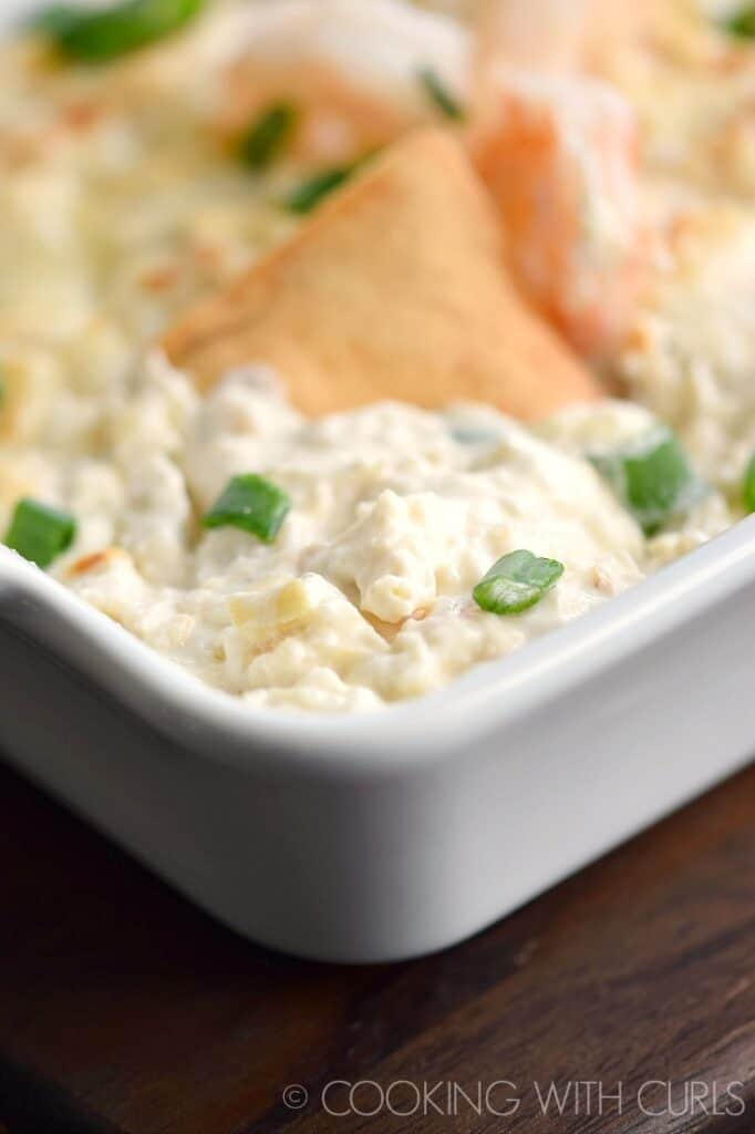 Simple Seafood Artichoke Dip in a white baking dish.