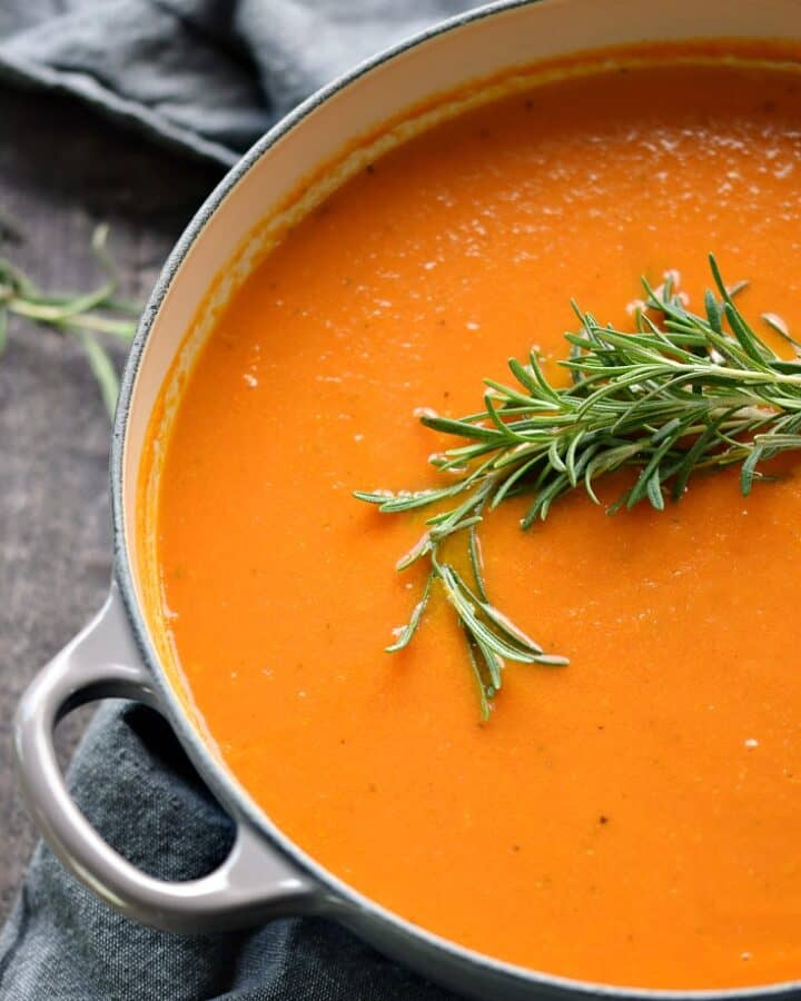 This thick and creamy Roasted Tomato Rosemary Soup in a large pot.