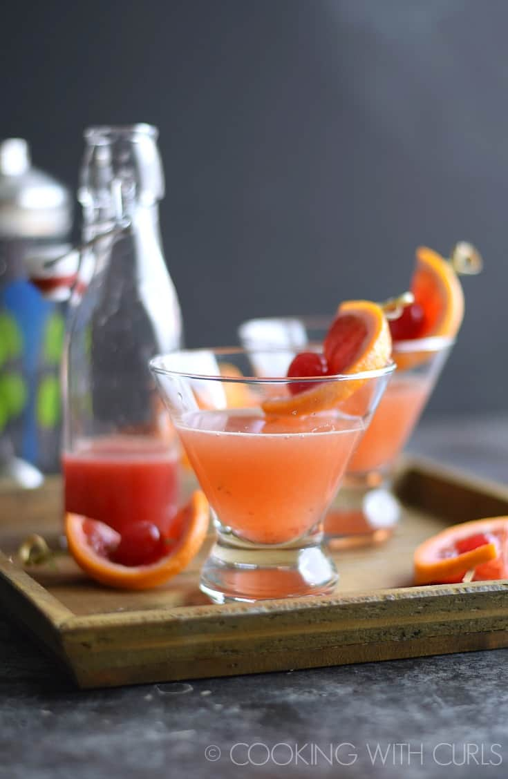 Blood Orange Martinis are the perfect cocktail for date night. They are tart, sweet, and such a pretty color! © COOKING WITH CURLS