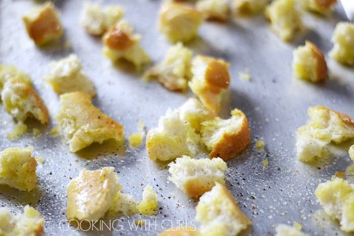 Classic Caesar Salad homemade croutons baked on a sheet pan