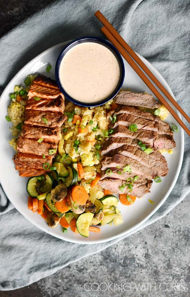 Japanese Hibachi Steak and Salmon served with fried rice, simple grilled vegetables, and yum yum sauce is the perfect date night meal! © COOKING WITH CURLS