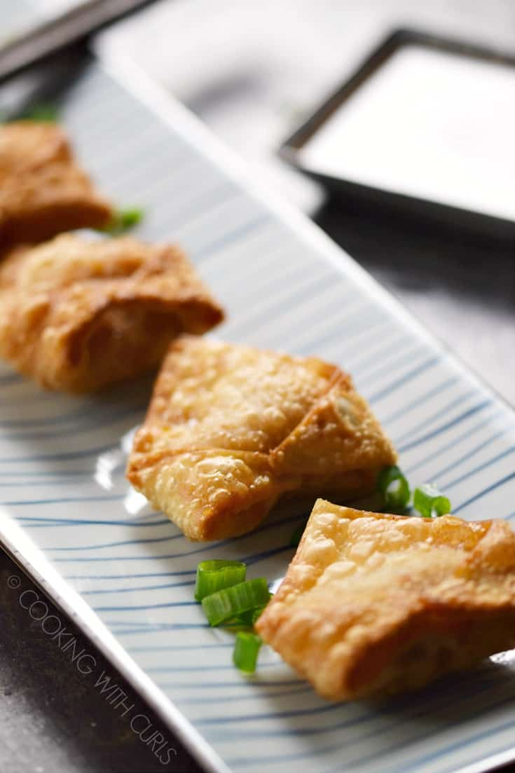 There is no need for take-out when you can make these amazing Crispy Pork Wontons at home! © COOKING WITH CURLS