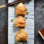 These Crispy Pork Wontons with Sweet and Sour Dipping Sauce are the perfect start to your meal or as a party appetizer! © COOKING WITH CURLS
