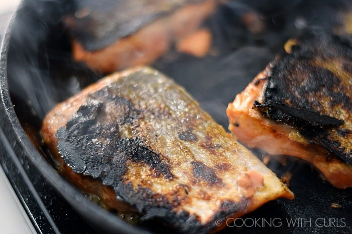 Flip the salmon over and cook on the other side © COOKING WITH CURLS