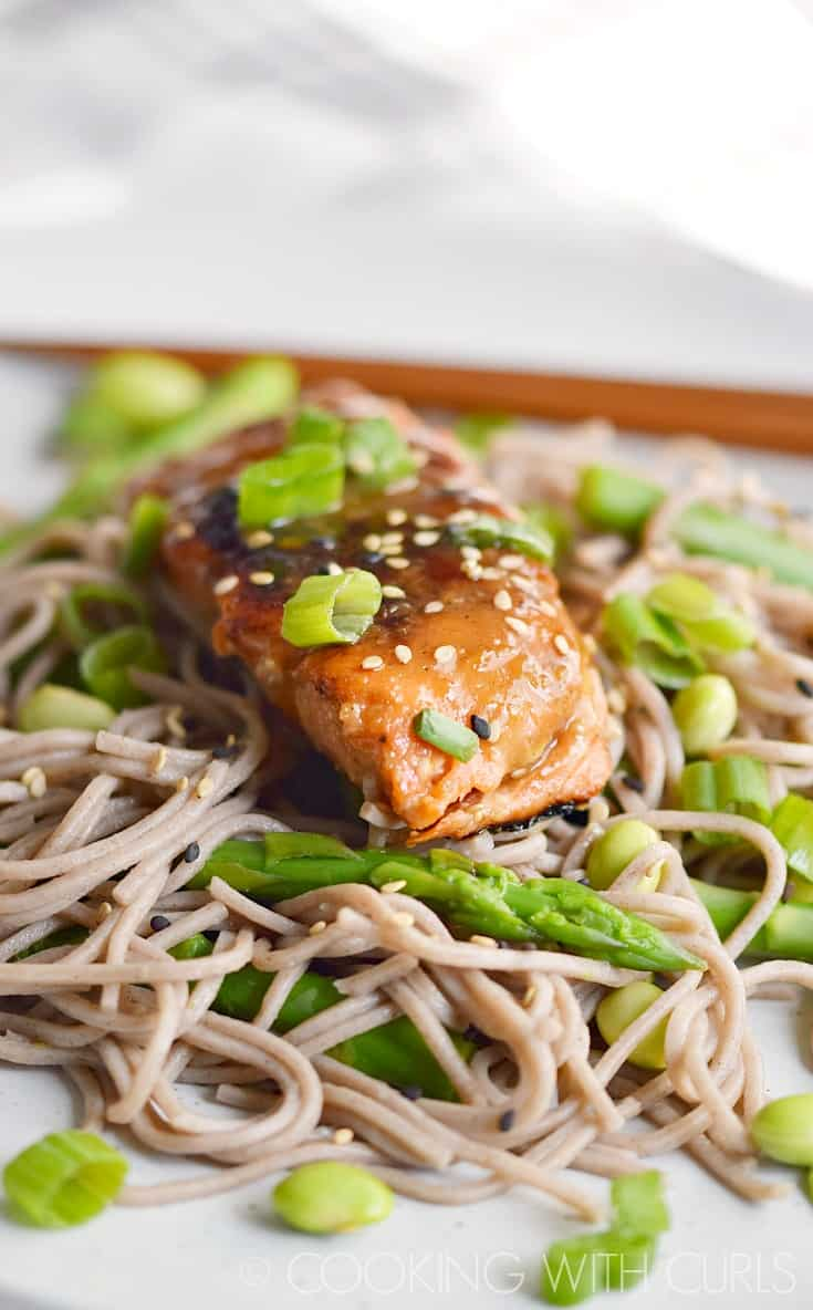 Miso-Ginger Glazed Salmon served on a bed of soba noodles, asparagus, and edamame © COOKING WITH CURLS