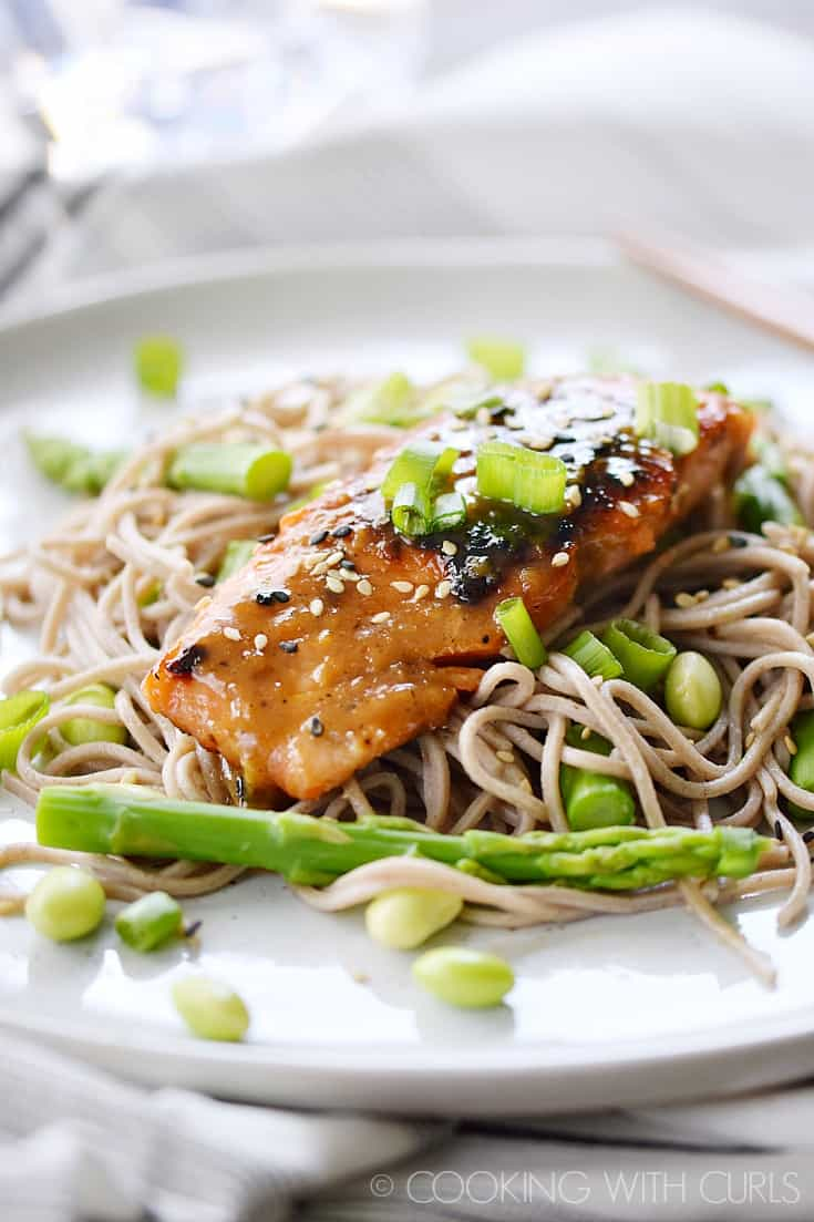 Miso-Ginger Glazed Salmon served on a bed of soba noodles, asparagus, and edamame is a deliciously simple meal any night of the week! © COOKING WITH CURLS
