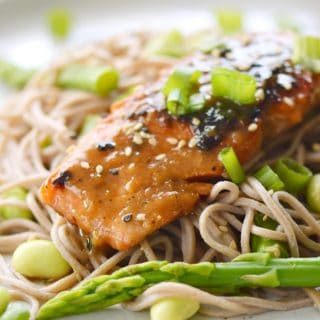 This Miso-Ginger Glazed Salmon is served on a bed of soba noodles that have been tossed with asparagus and edamame for a deliciously simple meal any night of the week! © COOKING WITH CURLS