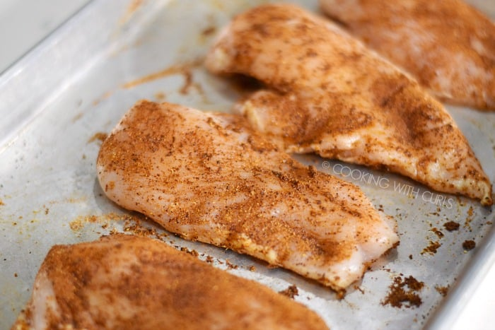A baking sheet with Tandoori Spice Mix rubbed over the chicken breasts © COOKING WITH CURLS