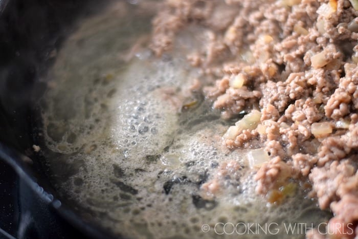 Drain the fat from the skillet © COOKING WITH CURLS