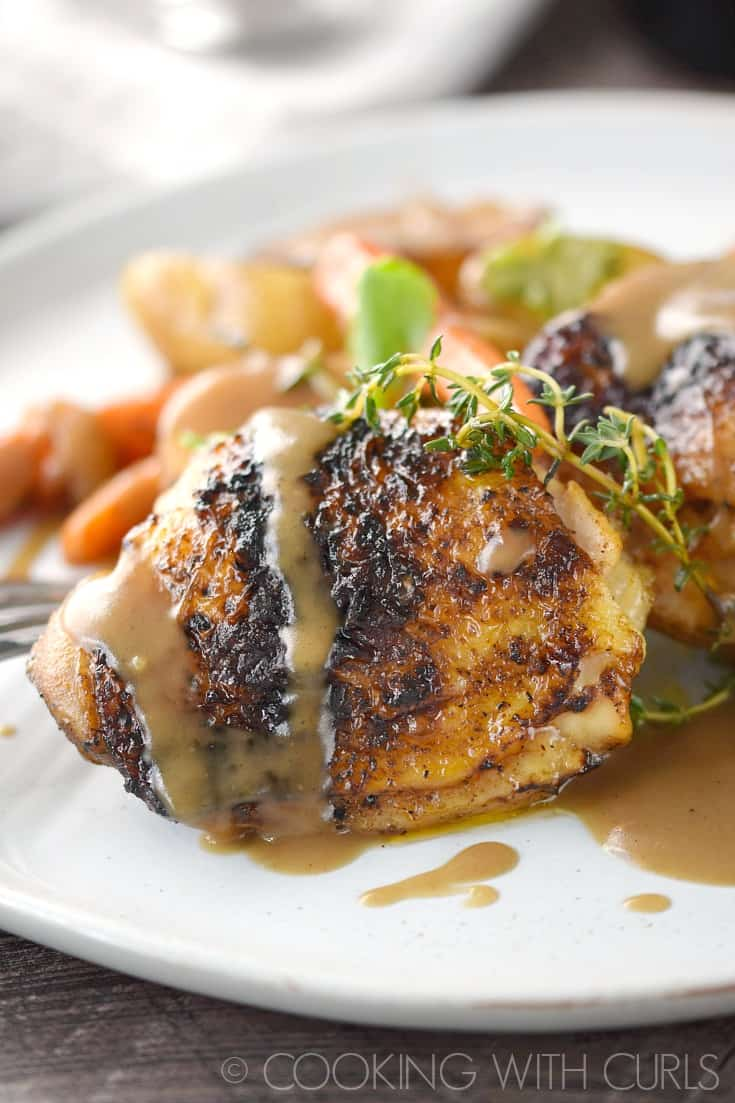 Guinness Beer-Braised Chicken Thighs are easy enough for weeknight meals, and fancy enough to impress dinner guests! © COOKING WITH CURLS