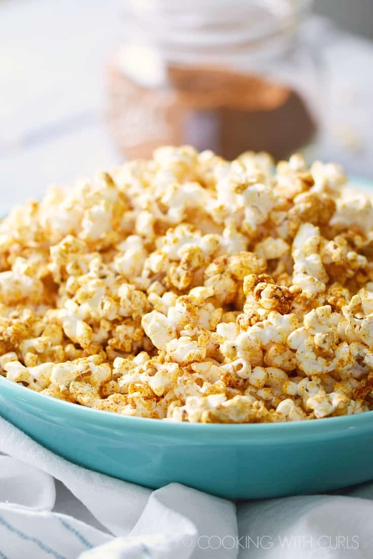 Tangy, savory and delicious Taco Popcorn is always a crowd pleaser! © COOKING WITH CURLS