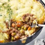 This Classic Shepherd's Pie recipe is made with lamb and topped with fluffy mashed potatoes! © COOKING WITH CURLS