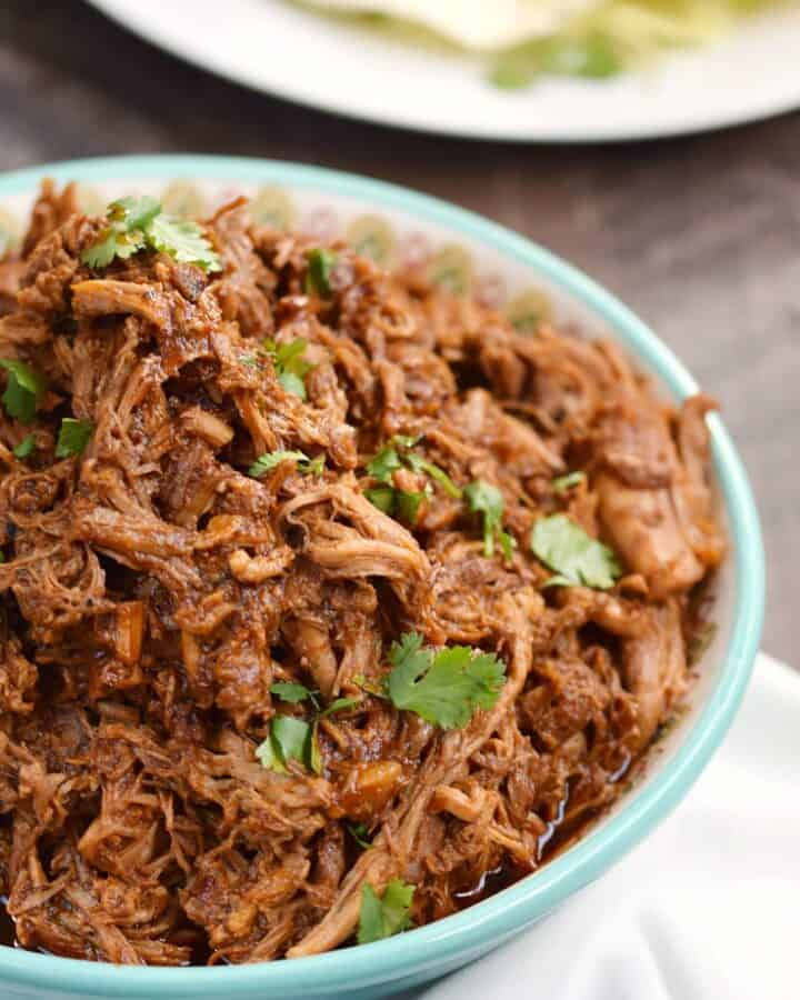 Instant Pot Red Chile Pork is a rich and tender filling for your soft tacos and tamales that will have your family asking for more! © COOKING WITH CURLS