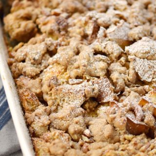 Waking up in the morning just got sweeter with this easy Cinnamon French Toast Bake baking in the oven! © COOKING WITH CURLS