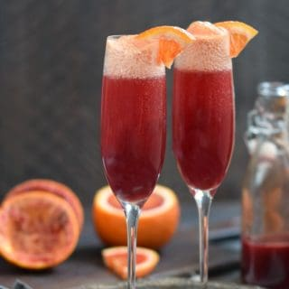 A Blood Orange Mimosa adds some sparkle and fizz to your brunch menu, and they are simple to make! © COOKING WITH CURLS