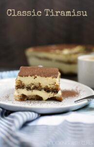 A slice of Classic Tiramisu is the perfect ending to a delicious meal. Creamy filling, coffee soaked ladyfingers, and some liqueur if you choose! © COOKING WITH CURLS